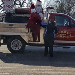 Santa Coming off the Fire Truck